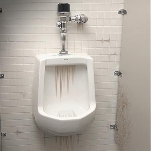 urinalbefore - Restroom Sanitation